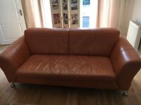 Two 3 seater Leather Settees - burnt orange colour. Both in good condition. Collection only