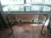 "Glass top dining table. 30""x 48""Good condition. Glass top does dismantle from the frame.No chairs"