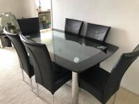 Heavy glass dining table and 6 chairs