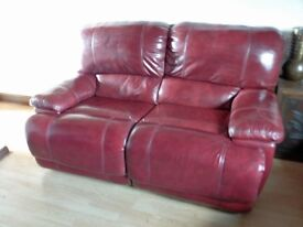 two deep red leather sofas, manual recliners, two and three seater