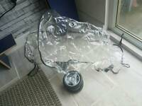 sliver cross pushchair raincover & spare wheel