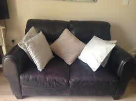 2x2 seater brown leather sofas. Excellent condition.