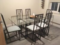 Glass table & 6 metal chairs