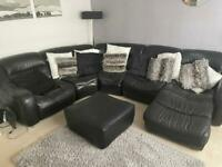 Corner sofa with footstool. Black leather.
