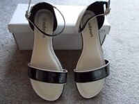 Brand new boxed Odeon sandals size 4