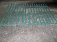 large green steel fence