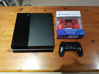 Playstation 4 with 2 controllers and 14 games