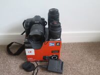 Sony a65 camera, three lenses, battery, battery charger and original box