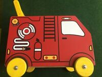 Child/ baby walker. Red wooden fire engine! Also acts as storage. Great design