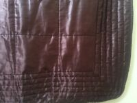 Chocolate brown satin quilted bedspread.