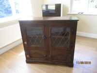Reproduction oak bookcase with leaded glass doors