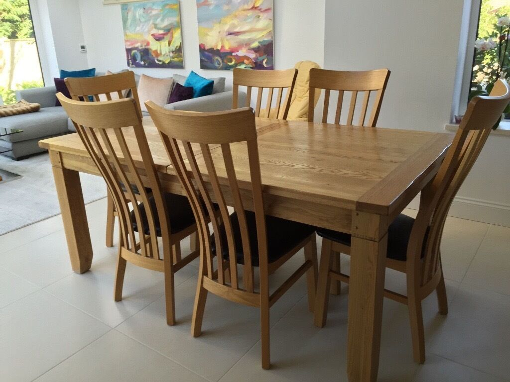 Beautiful solid oak extendable dining table and 8 chairs for Beautiful dining table and chairs