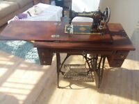 JONES VINTAGE SEWING MACHINE and accessories and parts.