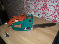 black and decker electric chainsaw with 2 extension cables works perfect no longer used