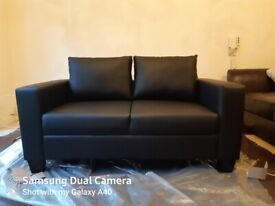 Brand New sealed black 2 seater sofa sale or swap