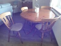 extendable polished pine dining room table and four chairs, all in very good condition