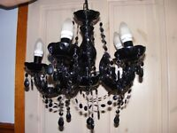 A black acrylic 5 arm crystal chandelier in very good condition