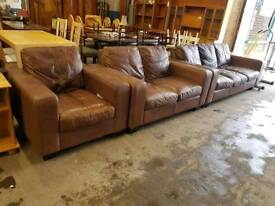Large Brown Leather Three Seater Sofa With matching two seater and matching armchair