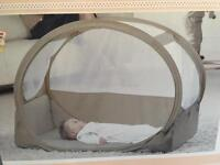 The pop-up bubble microlite travel cot