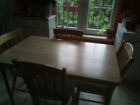 Wooden kitchen table and 4 chairs. Excellent condition.