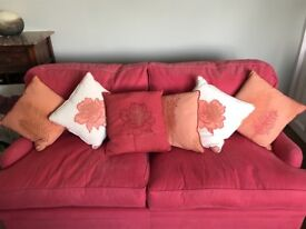 Excellent condition wide two seater feather filled sofa with matching cushions. Top craftsmanship