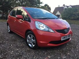 2009 ,59 PLATE HONDA JAZZ RED ,AUTOMATIC ,LOW MILEAGE ,MOT & TAXED ,GRAB A BARGAIN ...