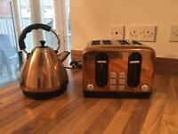 Matching copper bronze kettle and toaster