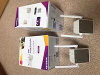 Two Netgear WiFi extenders, 1,200 sq ft range