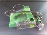 Electric planer with bag and clamp