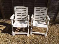 2 folding plastic chairs