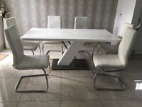 Quatropi High Gloss Rectangle Table with 6 White Faux Leather Chairs