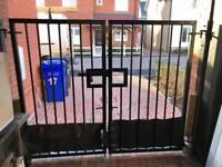 8ft wide x 7ft tall lockable iron gates and wall plates - dismantled and ready for collection