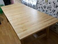 Large extending wooden dining table