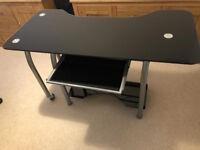 Black and silver glass swivel desk