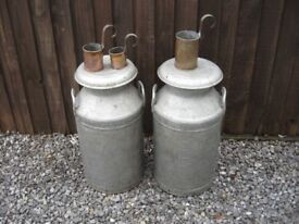 2 old Kirby and west aluminium milk churns with ladels/ milk measures.