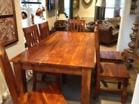 Solid Batu hardwood dinning table and 6 chairs
