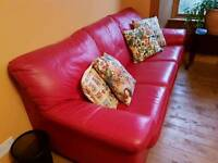 Red leather couch and bed