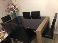 Black Gloss Dining table with 6 chairs For sale