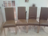 Four Fully upholstered Faux Leather Dining Chairs ( light oak legs)