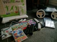 Wii console, wii fit plus with board, controls, games and more