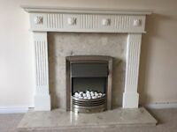 Marble back and hearth, electric fire and Adams mantle piece
