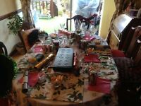 polished dining room extending table and six chairs