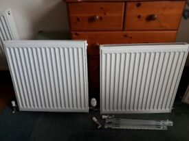 2 new radiators with brackets and valves. 600 x 600mm. £18 each or two for £30.