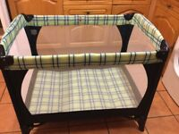 Mothercare baby travel cot in immaculate condition. Comes in a bag for easy transportation.