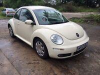 white VW Beetle Diesel