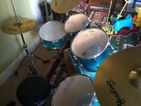 Mapex drum kit in teal including stool, cymbals and music books.