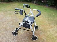 Four wheeled disability walker