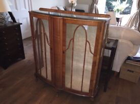Antique dark wood and glass cabinet with glass shelves