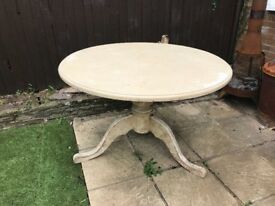 Round wood dining room table