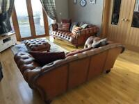 Brown leather 4 seater, 3 seater, arm chair, wing chair and footstool.